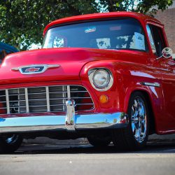 Customized red 1955 Chevy 3100