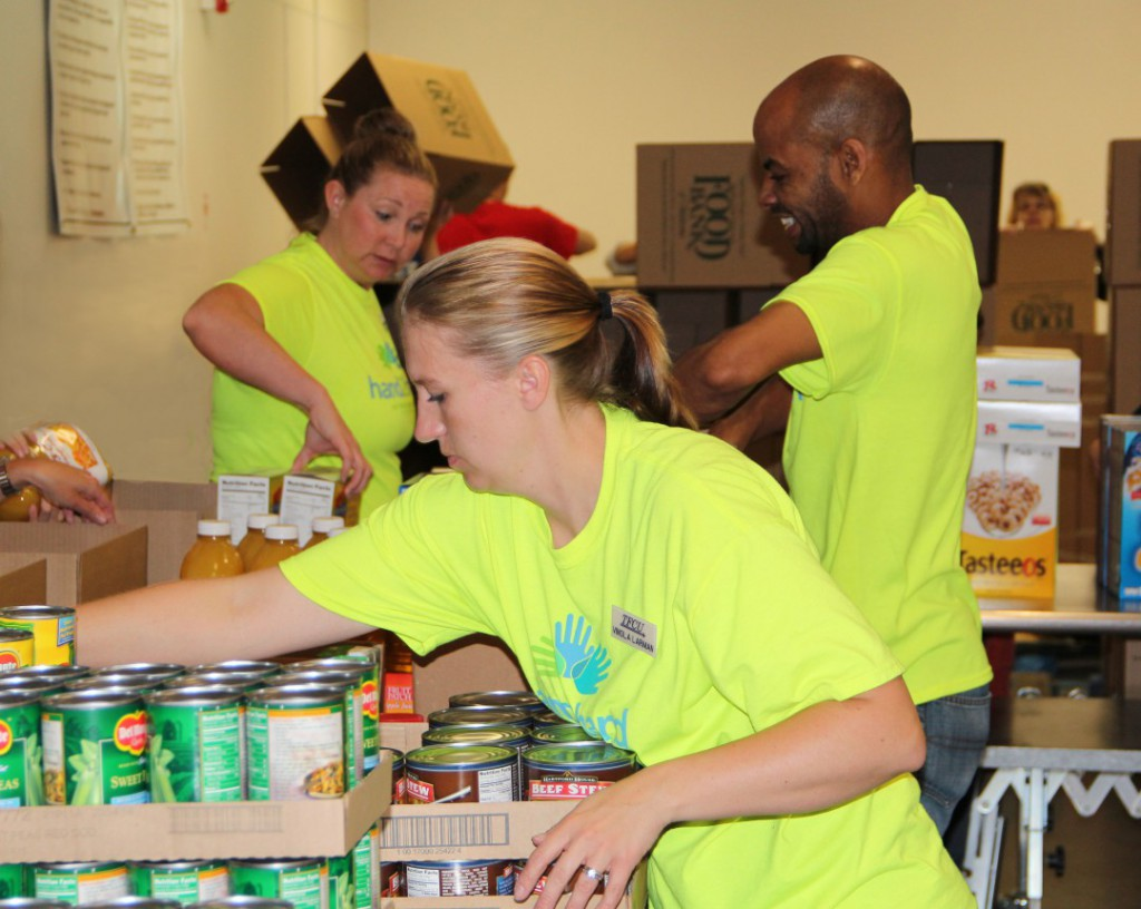 Employees volunteering for Hand2Hand