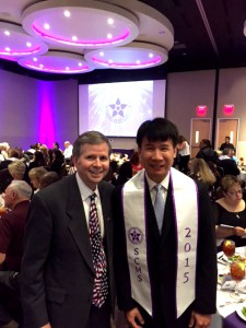 TFCU President/CEO Michael Kloiber (left) congratulating Chih Chen (right) at the 2015 CUNA Management School graduation.