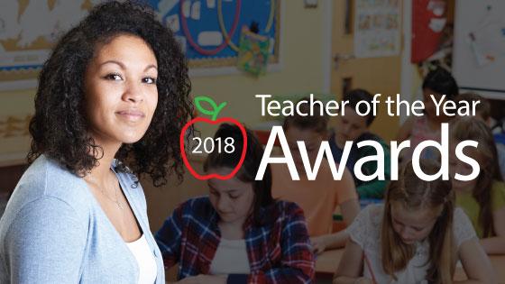 Teacher in blue sweater announcing TFCU's 2018 Teacher of the Year Awards
