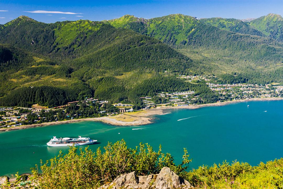 Panaramic view of Alaskan cruise ship pulling into harbor.