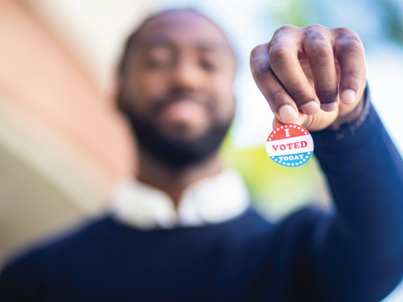 Man holding a voting sticker
