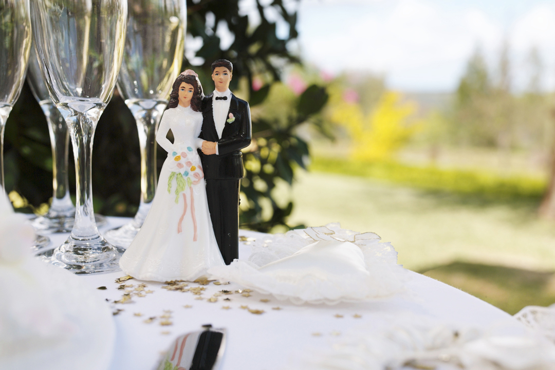 Bride and groom figurine on table by champagne flutes : Stock Photo View similar imagesMore from this photographer Bride and groom figurine on table by champagne flutes