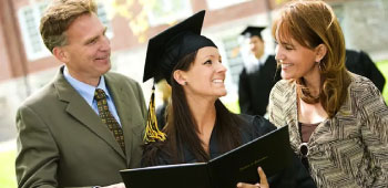 Parents smiling and congratulating daughter on her graduation from college
