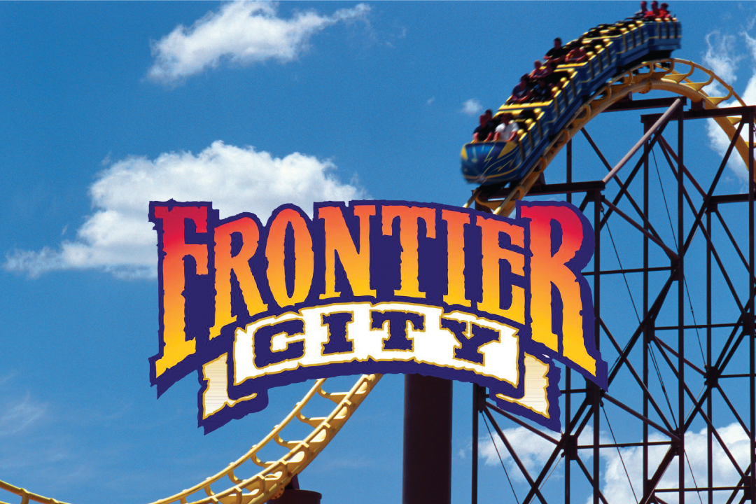 Close up of roller coaster behind Frontier City logo.