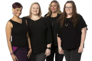 A group picture of the four women in the Member Solutions Group.