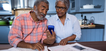 Older African American Couple planning for retirement