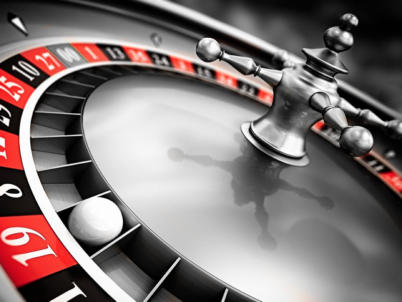 Close up view of tilted roulette wheel.