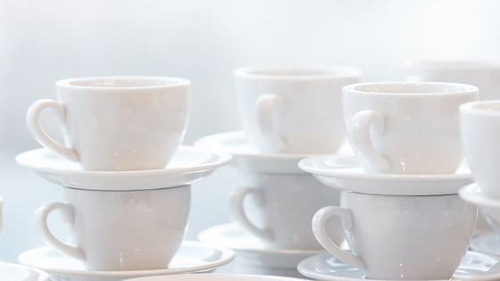 Close up of stacked white coffe cups
