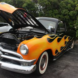 Black classic car with orange and yellow flames at the 2019 TFCU Miracle Car Show