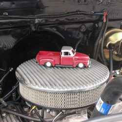 Car miniature on the engine breather of a classic at the 2019 TFCU Miracle Car Show