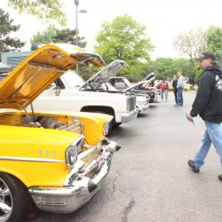 Yellow car with the hood up at the 2019 TFCU Miracle Car Show