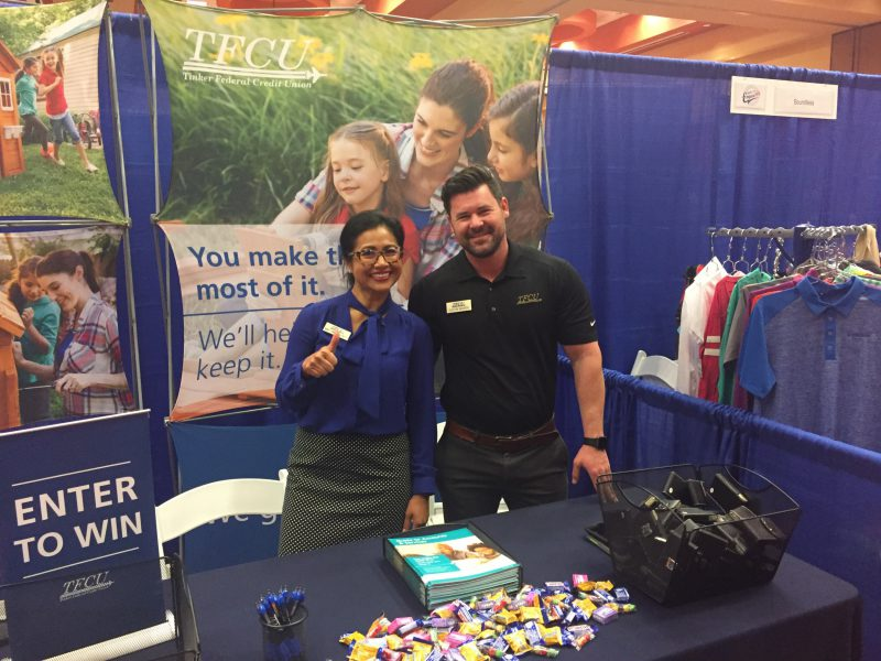 TFCU employees set up at community trade show