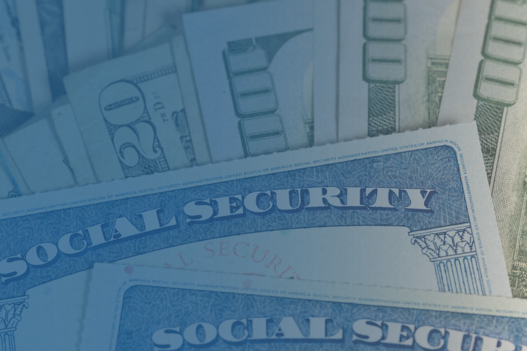 Hundred dollar bills and social security cards
