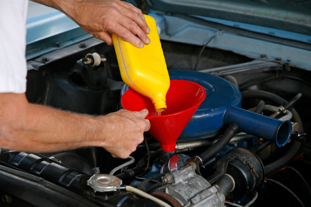 Man changing the oil in the vehicle