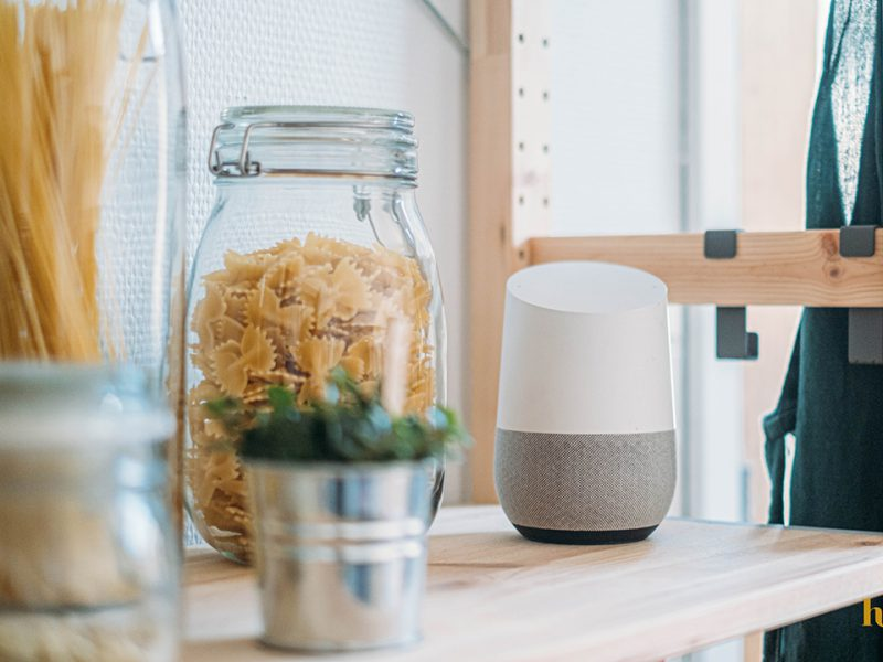 A smart voice device on a kitchen counter